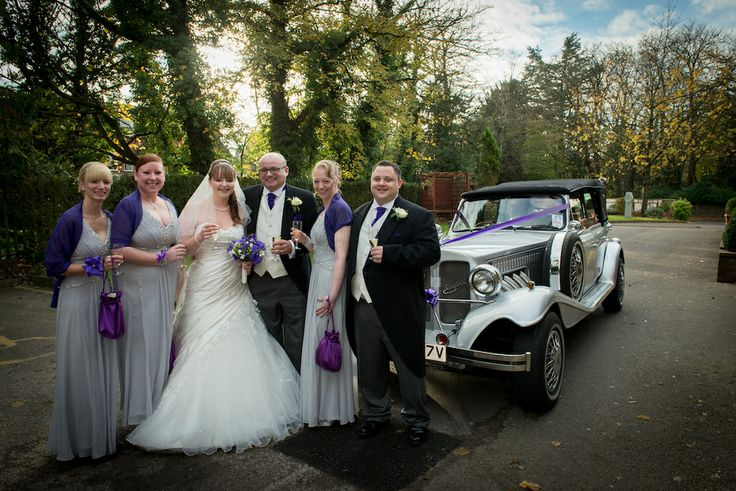 bridal party in front of gorgeous vintage bentley