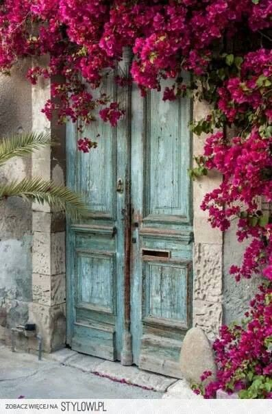 such a beautiful vintage door with a decoration of flowers, perfect