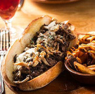 Amada's Cheesesteak - Wagyu Sirloin, Caramelized Onions, Mahón Fondue, Truffled Mushrooms
