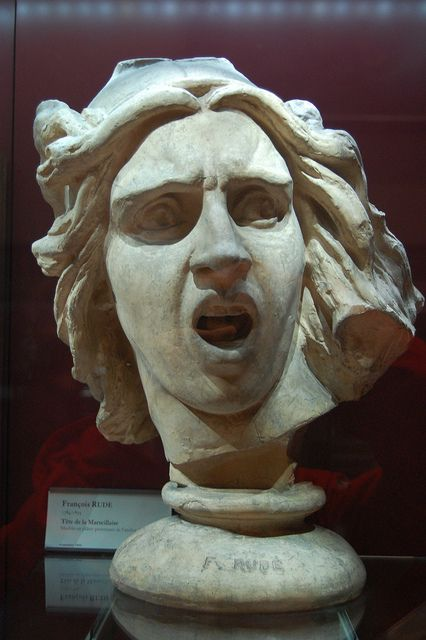 Screaming face statue,...