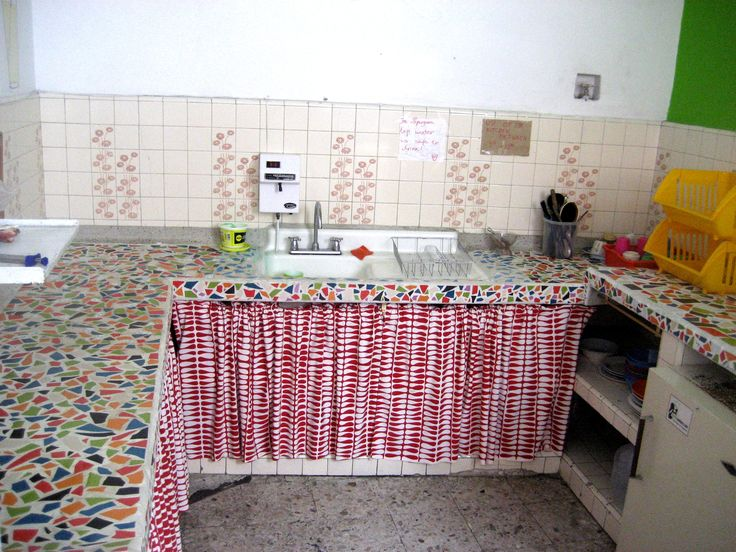 Communal kitchen in ParkLife Hostel Popayan. Well equiped with pans, frying pans, plates, cutting boards, fridge, cook, glasses, etc.