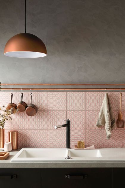 Beautiful brass lamp and saucepans with pink tiles... interiors Inspiration for my kitchen!