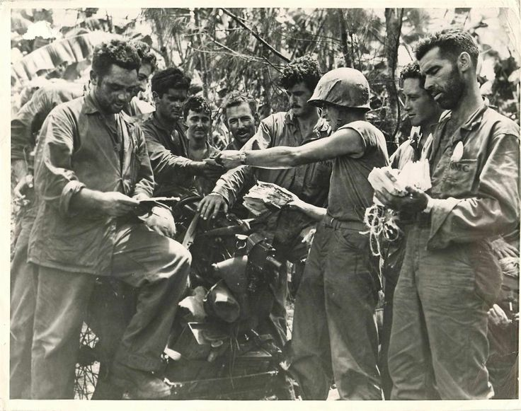 "1944- U.S. Marines during ""mail call"" on Tinian Island."