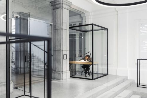 dezeen:  A 126-year-old school in Ljubljana features glass cabinets that resemble geometric line drawings »