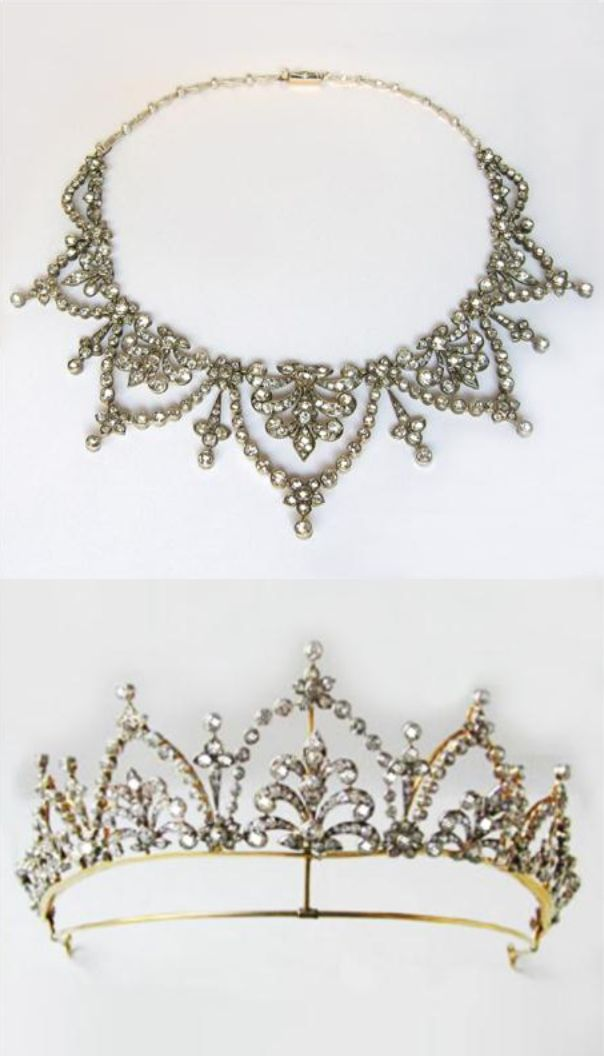 Victorian diamond necklace/tiara, of foliate design, with graduating scrolling tendrils within diamond arches, each surmounted by a flower cluster, set throughout with brilliant-cut and cushion-cut diamonds, weighing a total of approximately 30 carats, silver set and mounted in gold, circa 1880.  Bentley and Skinner own the images