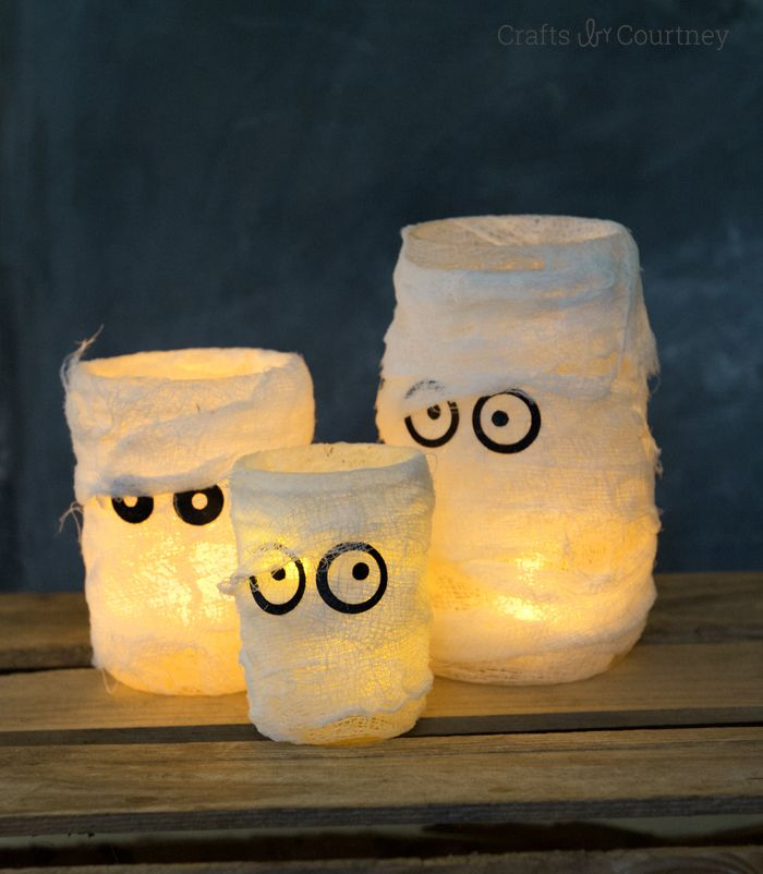 You can make these mummy Halloween luminaries for a fraction of what they cost in a popular catalog . . . and they look just as good! Courtesy of MichaelsMakers Mod Podge Rocks