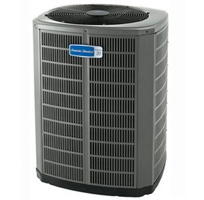 Photo of a heat pump central air conditioning unit.