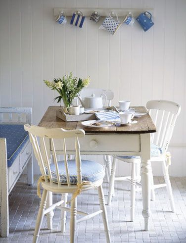 Uneven wooden table and chairs, blue and white pottery