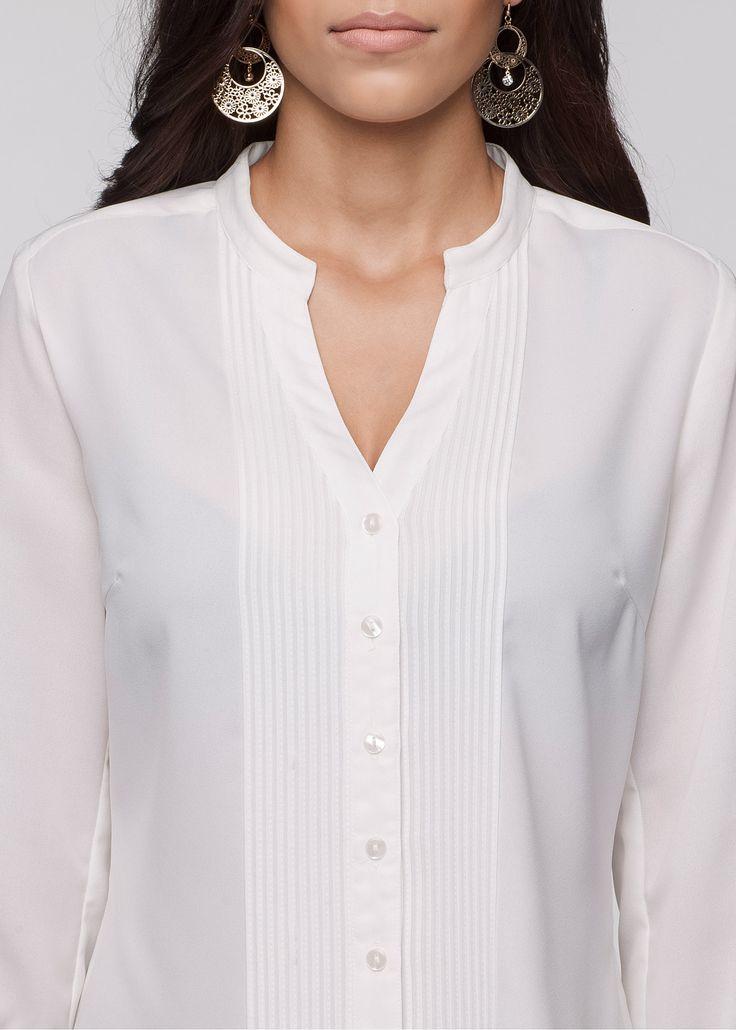 Confira:Camisa no modelo gola de padre mangas 3/4 com elástico e nervuras ao longo da aba de botões. Tecido levemente transparente. Com calça social é perfeita combinação para ir ao trabalho! Disponível em diferentes cores. Comprimento de aprox. 62cm no tam. 40.