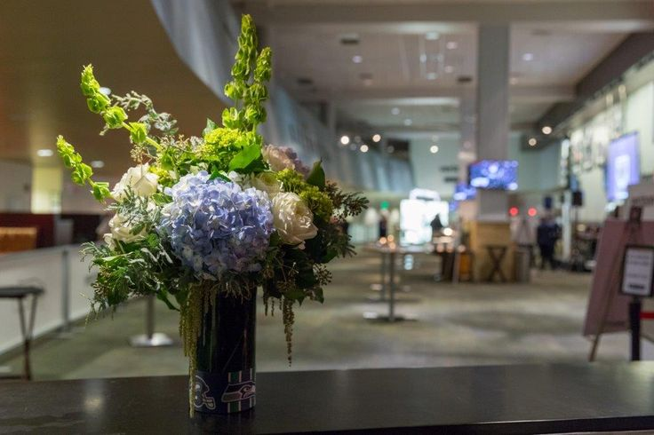 Go Seahawks! Floral arrangements created for the Washington State Auto Dealers VIP Party for the 2017 Auto Show at the CenturyLink Field Events Center in Seattle. We wanted them to subtly speak to the home team without being gimmicky. Photo by Kristin Zwiers Photography.
