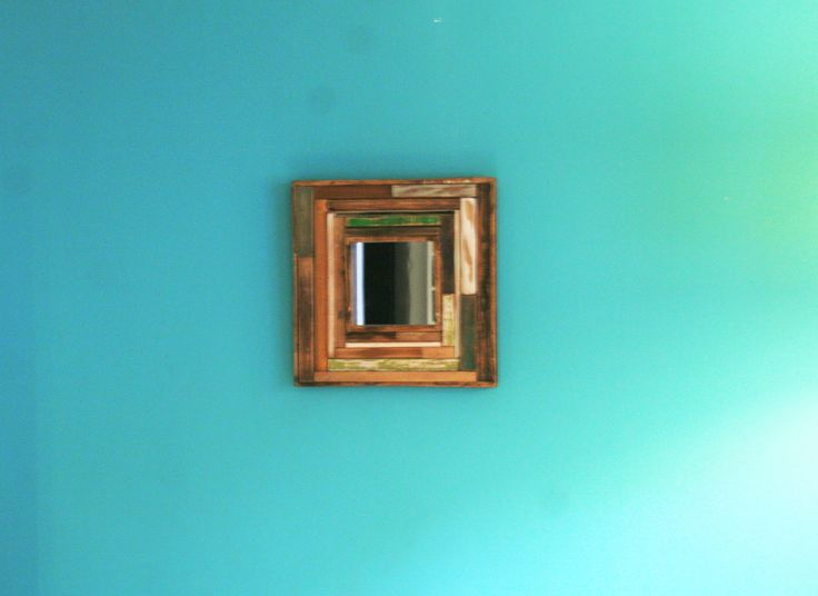A unique piece. mirror from reclaimed wood.  https://diziedesignf.patternbyetsy.com