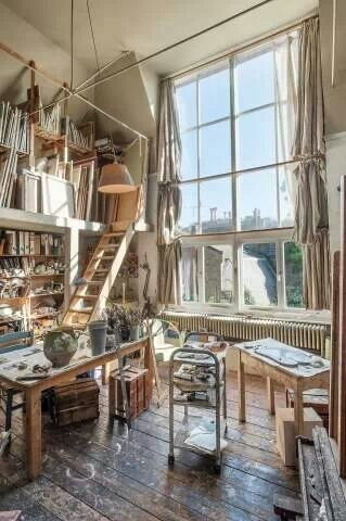 High ceiling and large window, storage shelves above. Great studio space.