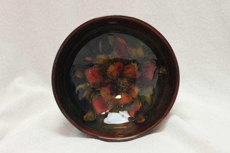 Dating from around 1950, theis small Moorcroft dish is decorated with the Columbine pattern under a flambe glaze. www.chinaroseantiques.com.au