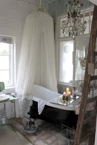 DIY::Shabby Chic Bathroom Decor Ideas  Forget the shabby; I just want the chic!  Imagine the chandelier and tub with tiffany blue :)