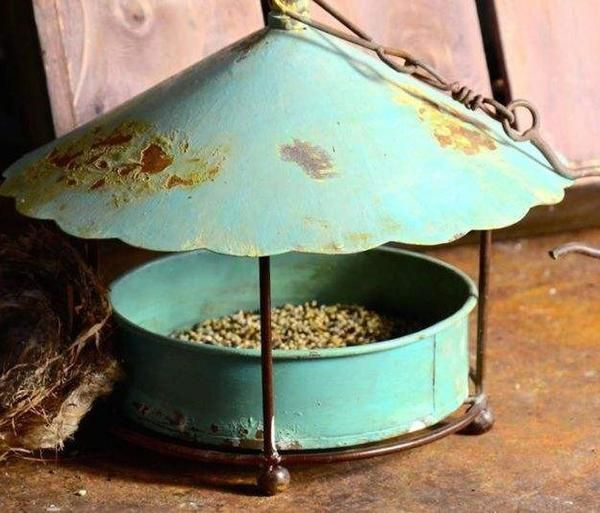 Rustic metal bird feeder brings vintage charm while attracting feathered friends. Unique hanging feeder is versatile for seed mixes, shelled peanuts, suet & nuggets, even fruit in summer. Features han