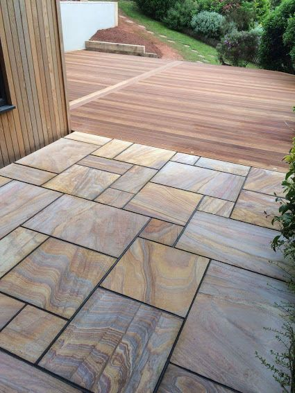 Hardwood balau decking and natural rainbow sandstone for Gardens with decking and paving