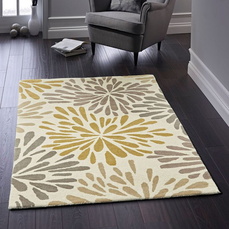 This decorative Flower Burst beige grey wool rug has a very unique design on a light coloured background and this is all you need to welcome this winter. #woolrugs #floralrugs #floralwoolrugs #handtuftedrugs #luxuryrugs #modernrugs