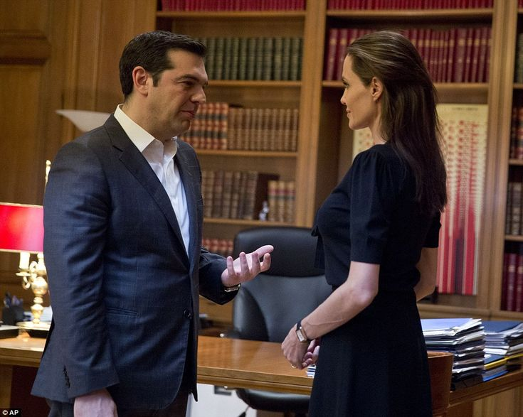 Greek Prime Minister Alexis Tsipras (left) welcomes American actress Angelina Jolie (right) during their meeting in Athens