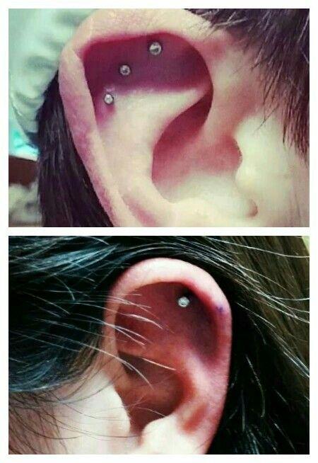 Triple cartilage piercing with Neometal by Kim AM