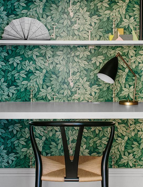 Fig tree wallpaper in home office with modern desk lamp