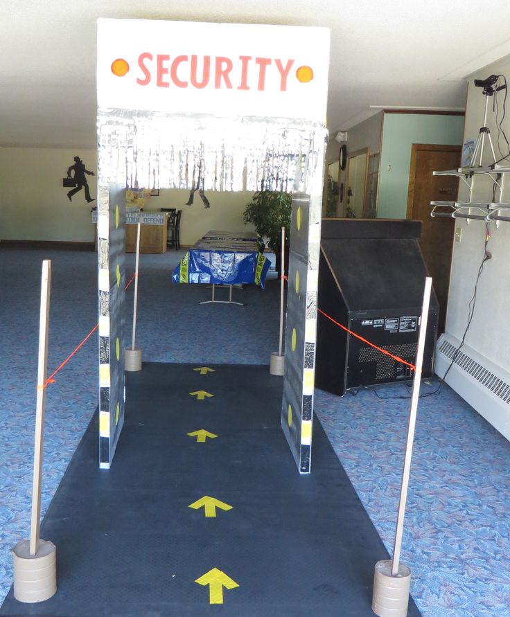 Security Entrance leading to registration tables. Camera and tv at right displays live images of kids as they enter.
