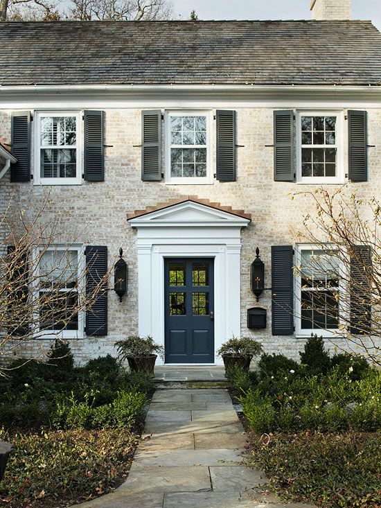 Add shutters for a bit of color to a neutral home's exterior.