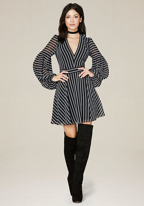 Striking dress in a chic double-stripe georgette. Playful balloon sleeves and flared skirt. Sexy deep V-neck. Front slash pockets. Hidden back hook-and-eye and zip closure. Partially lined.