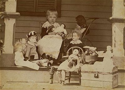 Antique photo of Gertrude Davey playing on her front porch with her dolls, Bristol, CT, circa 1889.