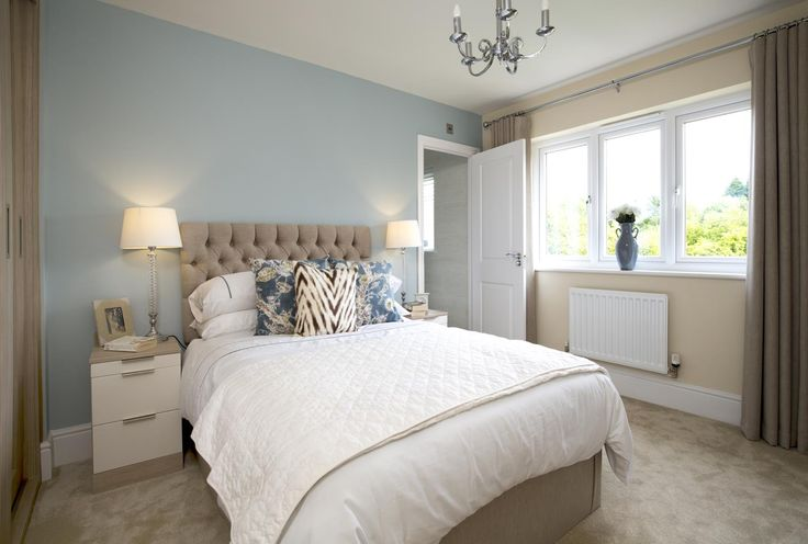 Pretty florals and inviting blue hues in this stunning guest bedroom. #bedroom #interiortrends