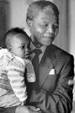 Nelson Mandela with his grandson in 1996.  What a lovely Gentle Man. Your integrity, strength, commitment and humble confidence, for the good of all man, inspires. God Bless You Mr. Mandela.