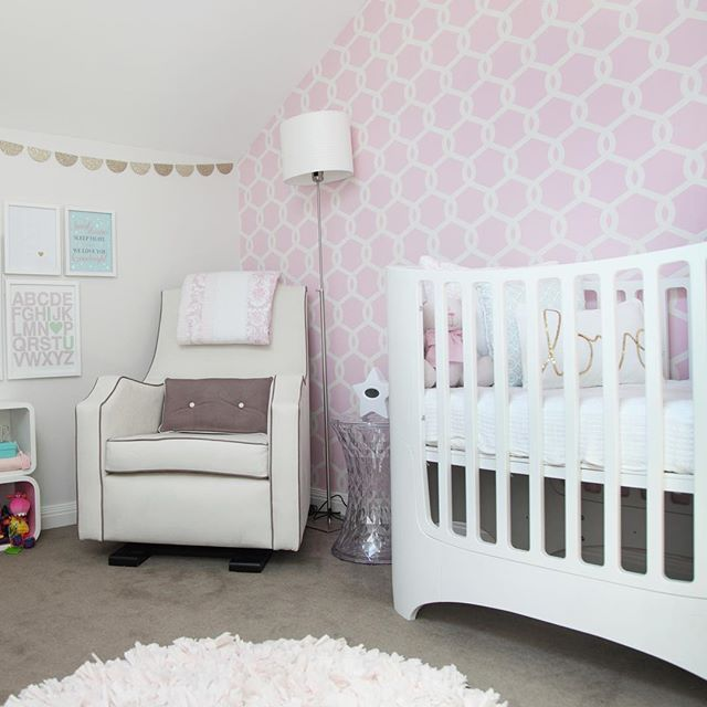 This sweet little attic space is filled with wonderful space-saving ideas. Check out our interiors title #beautifulbabiesrooms for more great tips! #kidsroom #childrensroom #babiesroom #nursery #book #interiordesign #decor #wallpaper #cot #crib #nursingchair #lighting