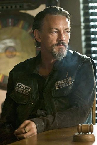 Chibs-Tommy Flanagan. They need to put subtitles up on screen when he talks-- we have to rewind repeatedly sometimes to figure out what he's saying half the time!