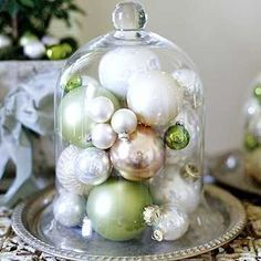 Holiday Decor with Ornaments under a Cloche. A simple, yet elegant, way to dress up the home for the holidays.