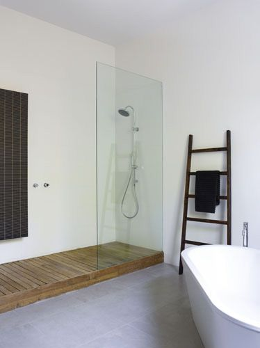 minimalistic bathroom. like the wood detailing in the shower.