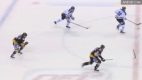 Hockey player flicks a stick from the ice to his teammate's hands