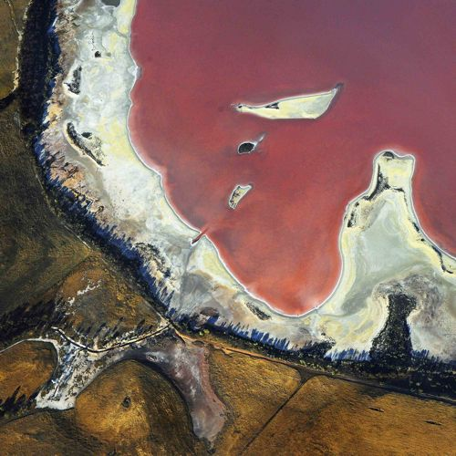 From a series of aerial shots of Western Australia by Tony Hewitt. Pink Lake, Stirling Ranges - 2012.