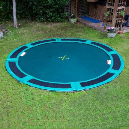 In ground trampoline pad that allows proper air flow and safety.