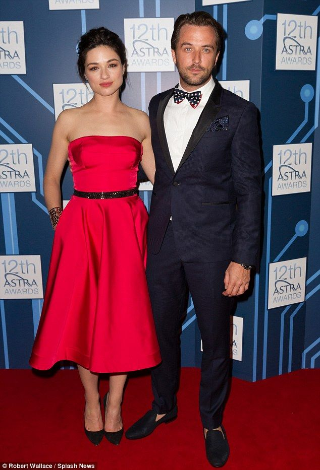 Crystal Reed (in Escada) and Darren McMullen