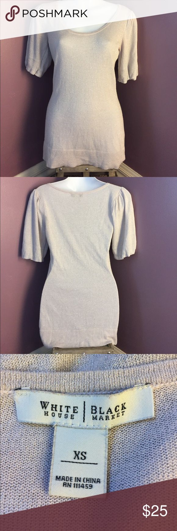 White House Black Market Silver Short Sleeve Top White House Black Market Silver scoop neck Knit Top. Sleeves have some gathering at the top and around the cuff. Measures 15 1/2 inches at bust and 27 inches from shoulder to hem. ❤️ Bundle and save!❤️ Excellent used condition 😊 White House Black Market Tops