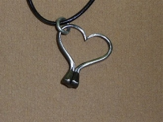 horse shoe jewelry with horse shoe nails just bents into a heart I have to try this!