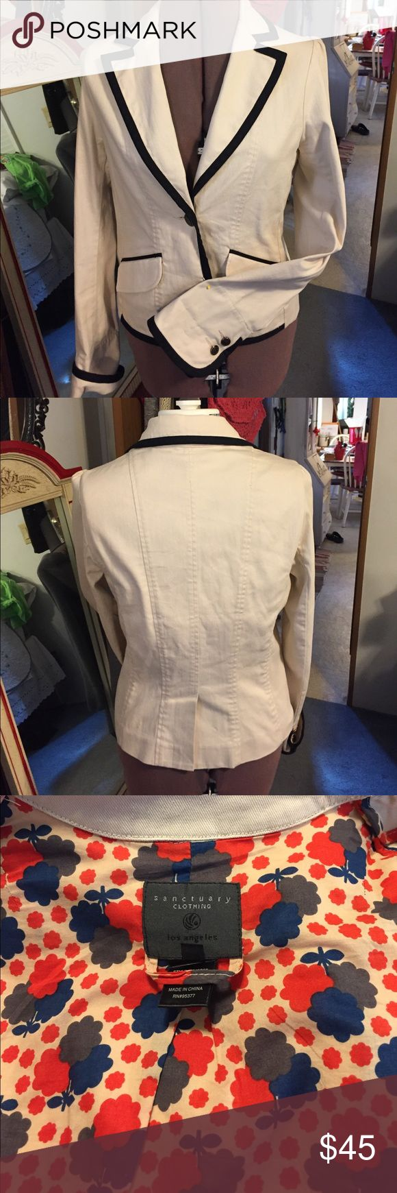 💕Beautiful off white jacket💕 Beautiful off white jacket with black trim.Beautifully made,well tailored. Has 2 real pockets. The cuffs are very unique, you can turn them up or down.Beautiful fabric on the inside.Not a heavy jacket,just right for cool nights.💕 sanctuary clothing Jackets & Coats Blazers