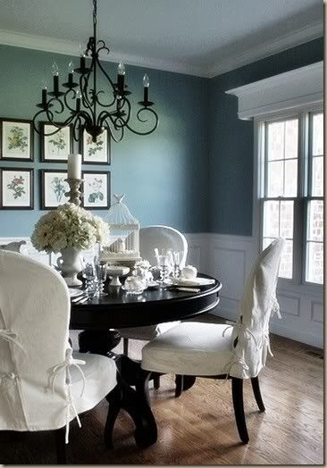 Paint: Sherwin Williams Interesting Aqua  (I also love the molding and the black accents.).... Paige! This looks just like your dining room!