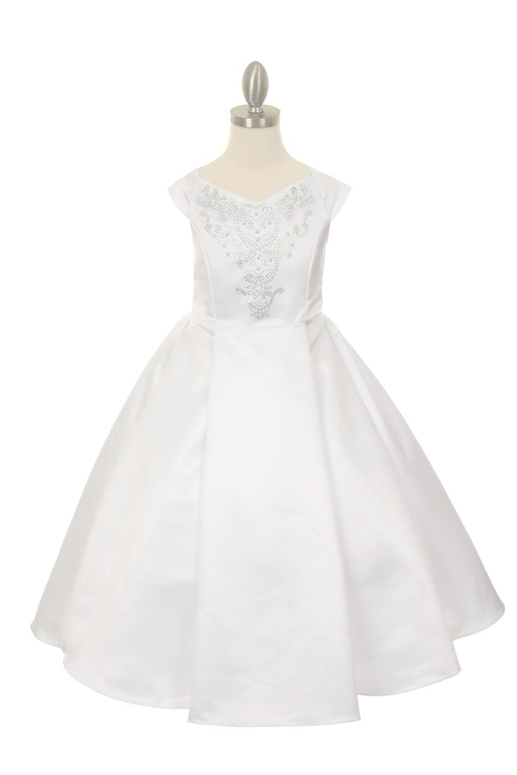 Millie: White Flower Girl Communion DressWhite Flower Girl Communion Dress This white communion dress is made from wedding quality matte satin and features a jeweled decored bodice with clear and white beads. This dress is fully line with sodt satinlining and a bottom layer of crinoline netting that can give more volume between the knee and the ankle.