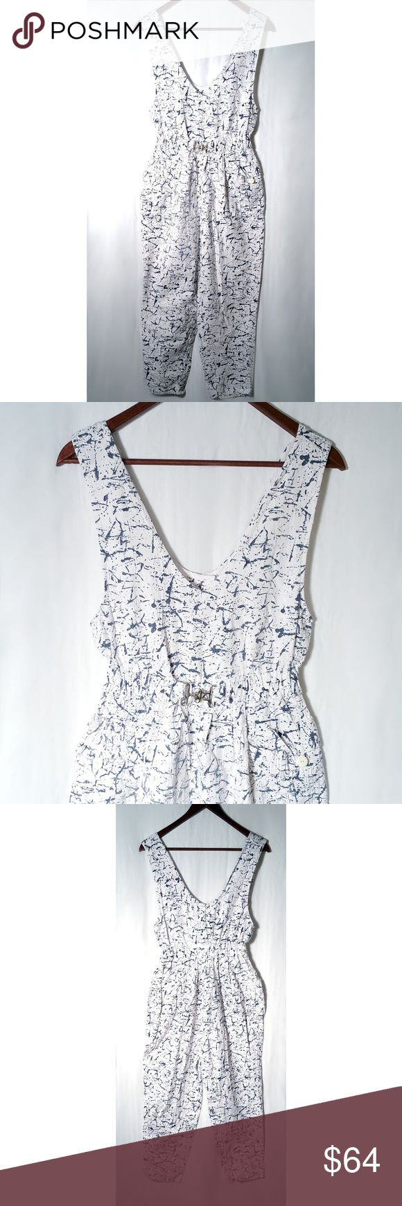 VTG 80s White Jumpsuit Blue Paint Splatter S/M AMAZING handmade vintage 80s sleeveless white jumper with elastic waist and metal buckle detail featuring all over blue paint splatter pattern!  There is not another one like this in the world!  Truly unique and comfy!  It also has several pockets!  No sizing tag but will fit like a S/M, please check measurements below.  Small snap closure at the back.  One small spot with light yellowing on one front buttoned pocket, see photos.  Measuremts…