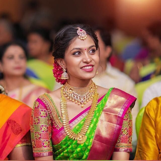 South Indian bride. Gold Indian bridal jewelry.Temple jewelry. Jhumkis.Pink and green silk kanchipuram sari.Braid with fresh jasmine flowers. Tamil bride. Telugu bride. Kannada bride. Hindu bride. Malayalee bride.Kerala bride.South Indian wedding.