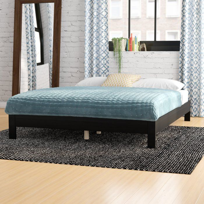 Classic design meets understated chic with this on-trend platform bed. Made from yellow meranti wood with aluminum hardware, this design's simple, box-shaped base includes four legs, side rails, cross slats and a center support. Create an eclectic ensemble in the master bedroom, start by rolling out an overdyed area rug in the center of the floor, then place a walnut nightstand with an x-frame trestle base on each side of this stylish bed. Though this piece is compatible with most standard…