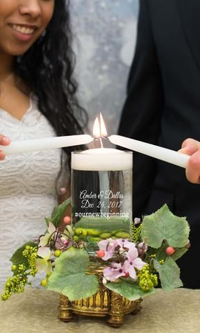 Wedding Unity Candle - this is lit to represent the bride and groom's lights coming together to create a brighter and stronger flame/light.