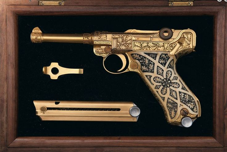 Gold plated luger pistol - rare firearms at the premiere collectors' firearms auction. True beauty...
