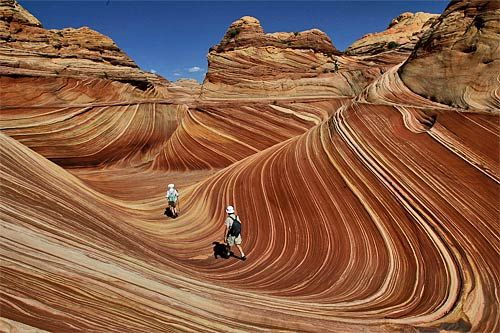 Wave-  The area near the Utah-Arizona line is a place of strange and delightful rock formations. In the Paria Canyon-Vermillion Cliffs Wilderness, the renowned Wave formation is made of Jurassic-age Navajo sandstone -- 190-million-year-old sand dunes turned to rock. Stacked one atop another, the dunes calcified in vertical and horizontal layers.