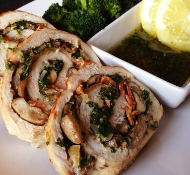Pork tenderloin stuffed with spinach, mushrooms, bacon and fresh herbs and topped with a lemon parsley oil drizzle.
